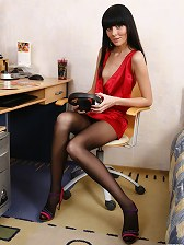 Sweltering brunette flashes her nyloned feet preparing for her hard workday